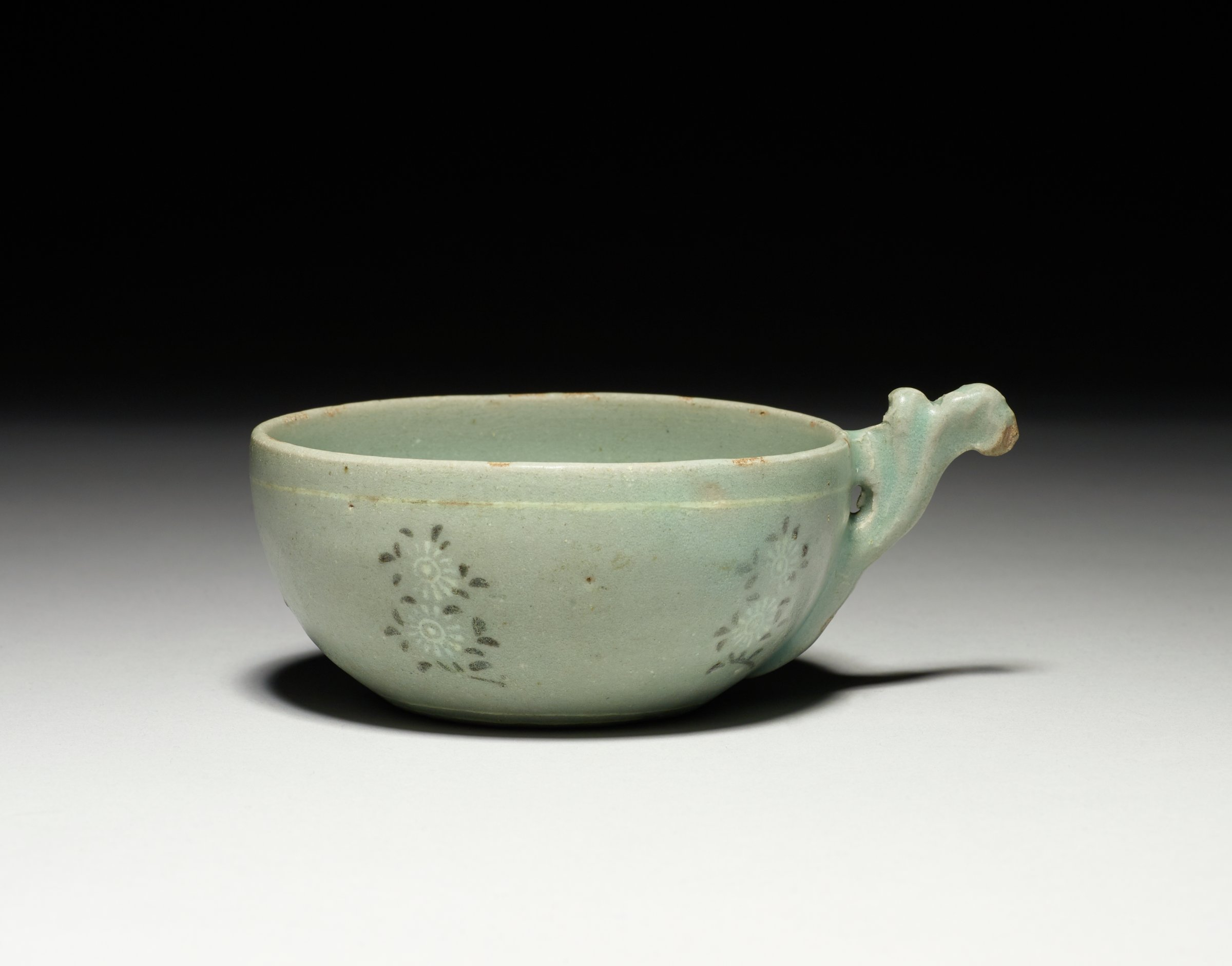 Cup with foliate handle, five sprays of chrysanthemums on exterior, with pale matte sea-green glaze