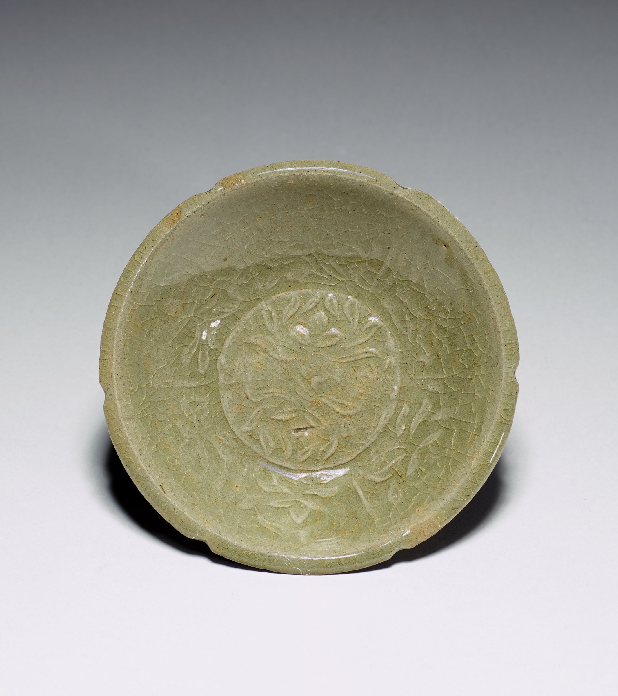 Celadon Glazed Shallow Dish with Molded Lily Motif
