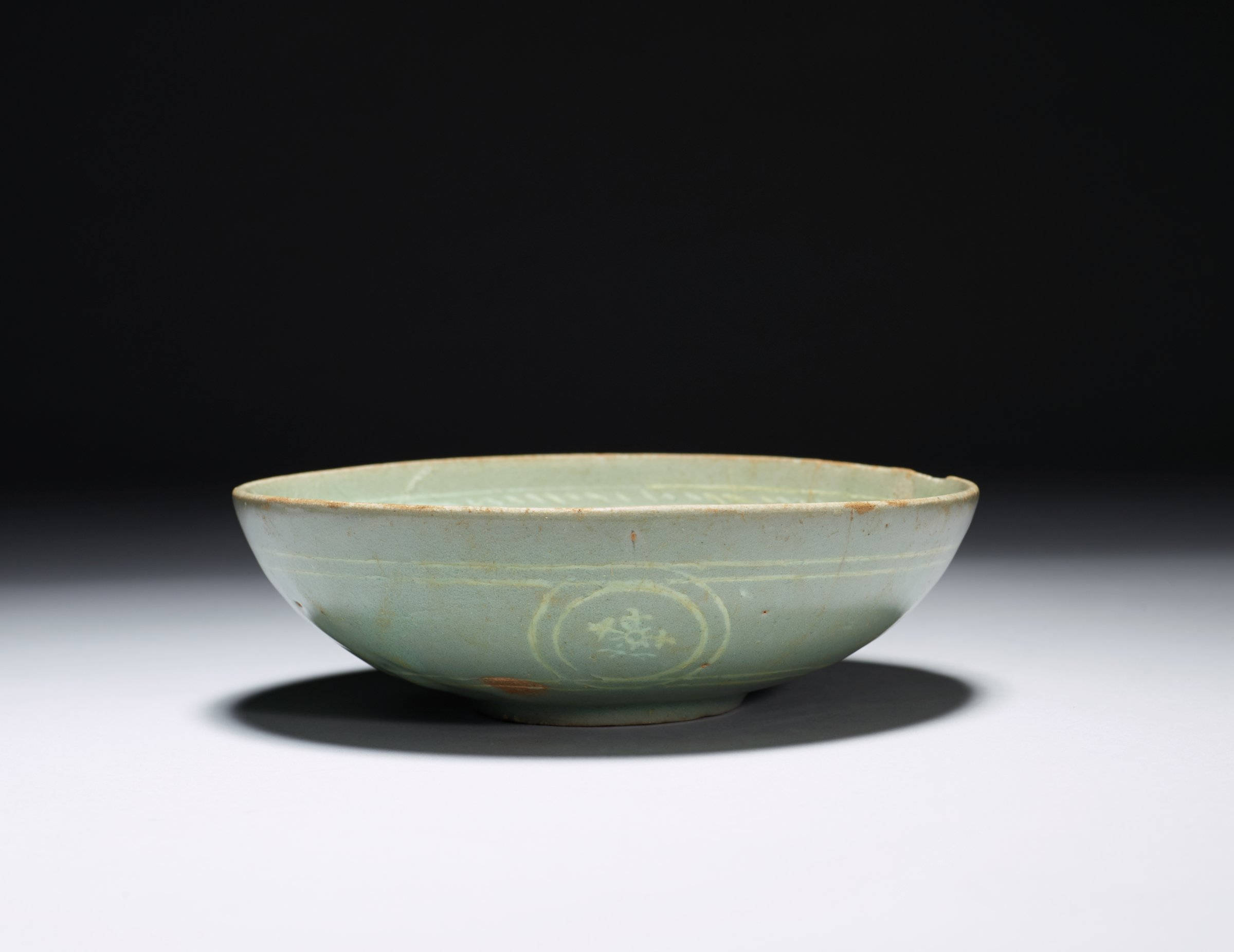 Celadon Bowl with Triple Lichee, Lotus and Chyrsanthemum Motifs in Inlaid Slip