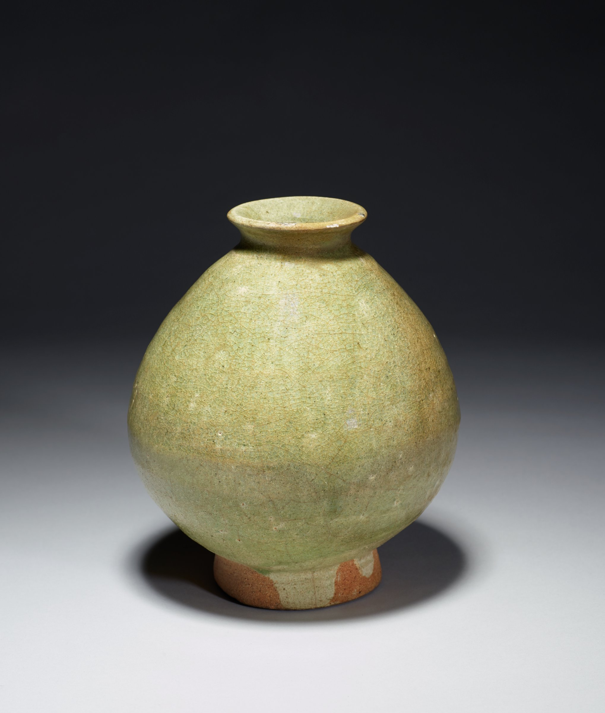 Bottle with plain straw-colored glaze.