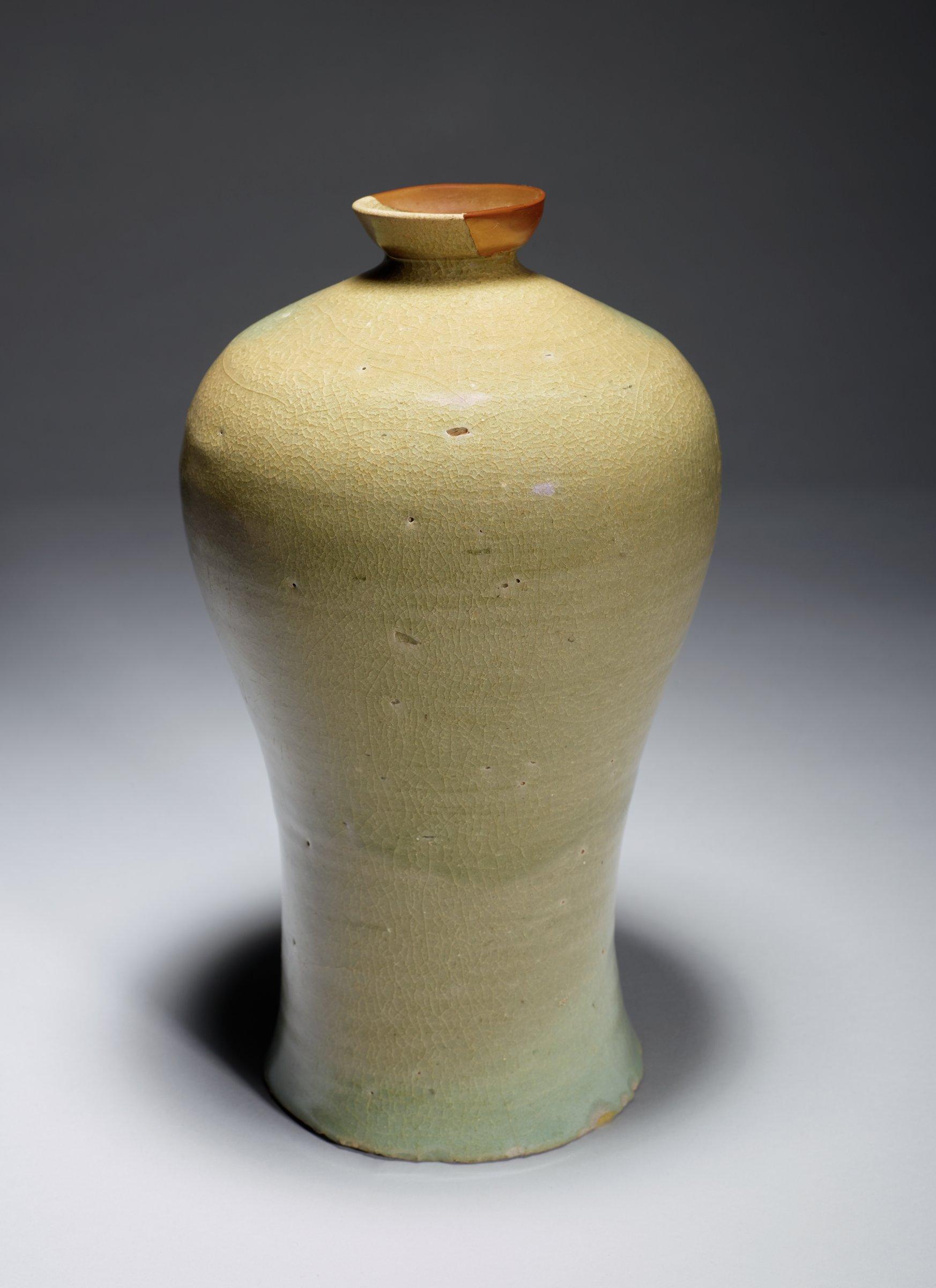 Celedon Glazed Plum Vase (Maebyong) with Gold Lacquer Lip, Korea, glazed porcelaneous stoneware, gold lacquer repair on lip. Some glaze on the underside. Darker celedon glaze over shoulder lighter glaze on lower half.
