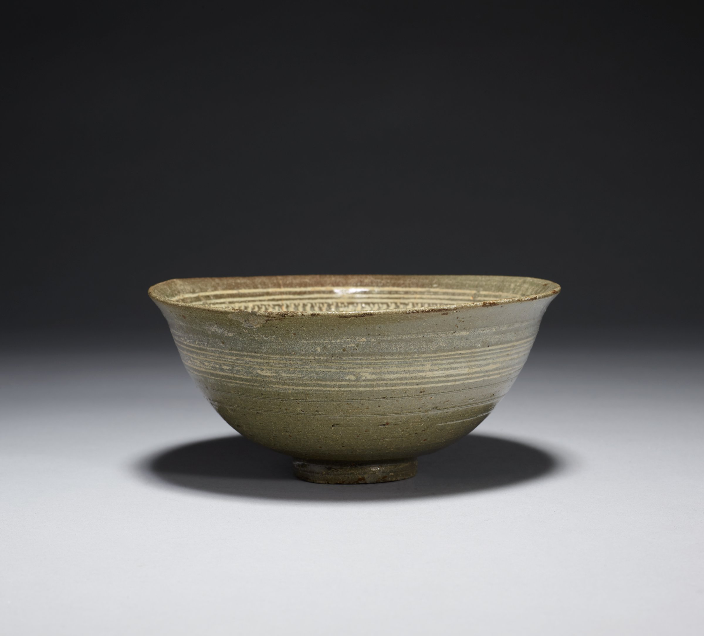 Bowl with Chyrsanthemum and Banded Motif Interior and Banded exteriorThree unglazed spur point in the interior. chipped lip and foot